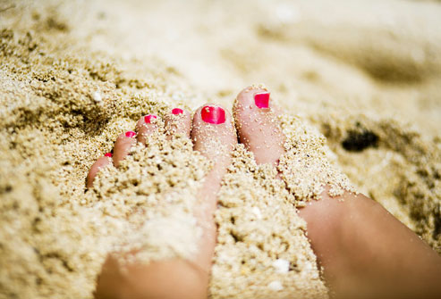 girl-feet-in-sand